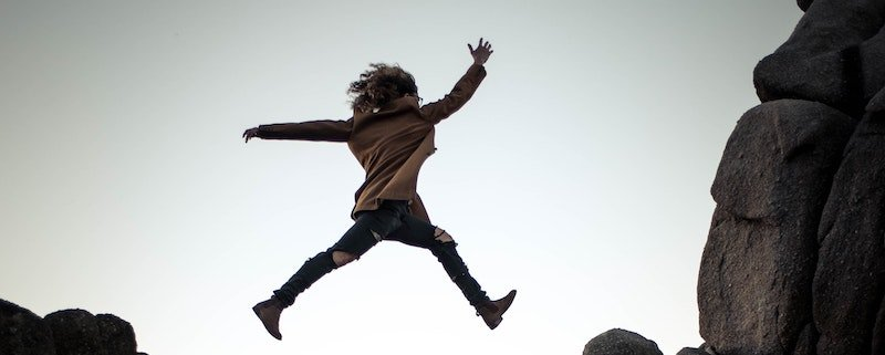 Girl jumping in the sky